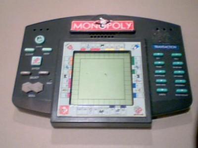 Hasbro Electronic Handheld Monopoly Board Game