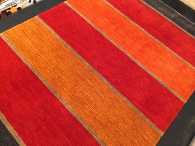 Carpet Couture Red, Orange, Brown Wool Area Rug