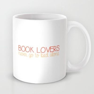 Astrode Book Lovers Never Go To Bed Alone Ceramic Mug