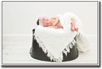 Athah Poster Baby sleeping on black bucket Paper Print