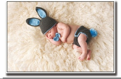 Posterhouzz Cute baby sleeping in bunny clothes Fine Art Print