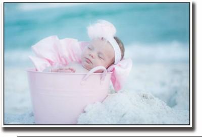 Posterhouzz Baby sleeping in pink bucket Fine Art Print