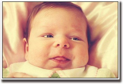 Athah Poster Baby sticking tongue out Paper Print