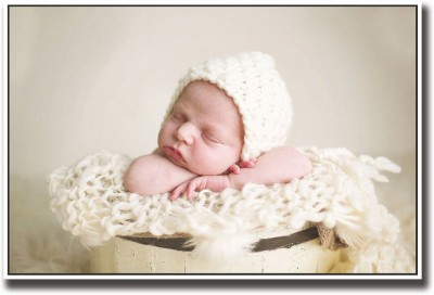 Athah Poster Baby sleeping in yellow bucket Paper Print