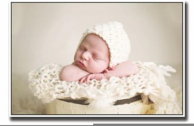 Posterhouzz Baby sleeping in yellow bucket Fine Art Print