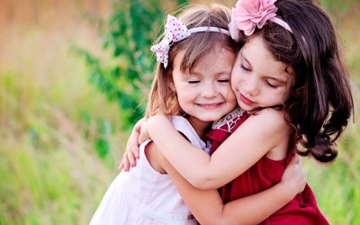 Small cute baby girls hug and love poster Paper Print