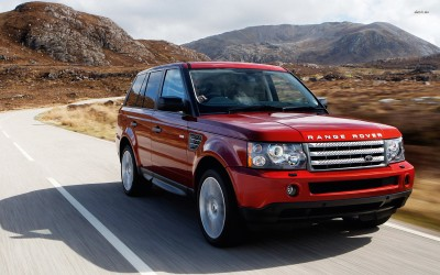 Athah 2009 Red Land Rover Range Rover on the road Poster Paper Print