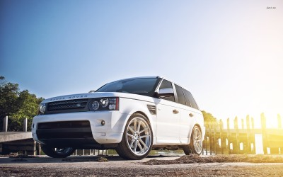 Athah Sun light shining behind the Land Rover Range Rover Poster Paper Print