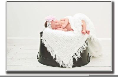 Posterhouzz Baby sleeping on black bucket Fine Art Print