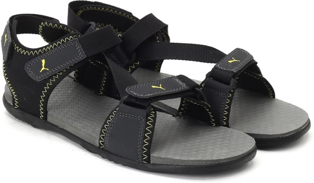 bce0820fb Puma Men Blk-dark shad-Blaz yelo Sports Sandals was ₹1395 now ₹